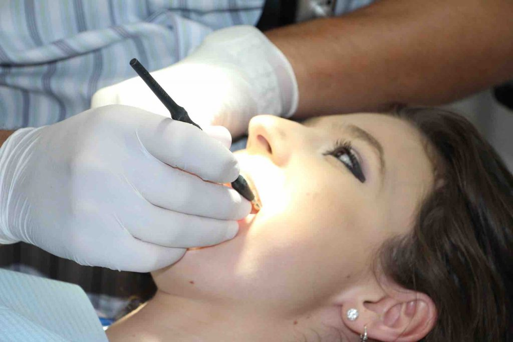 Woman getting a dental procedure completed